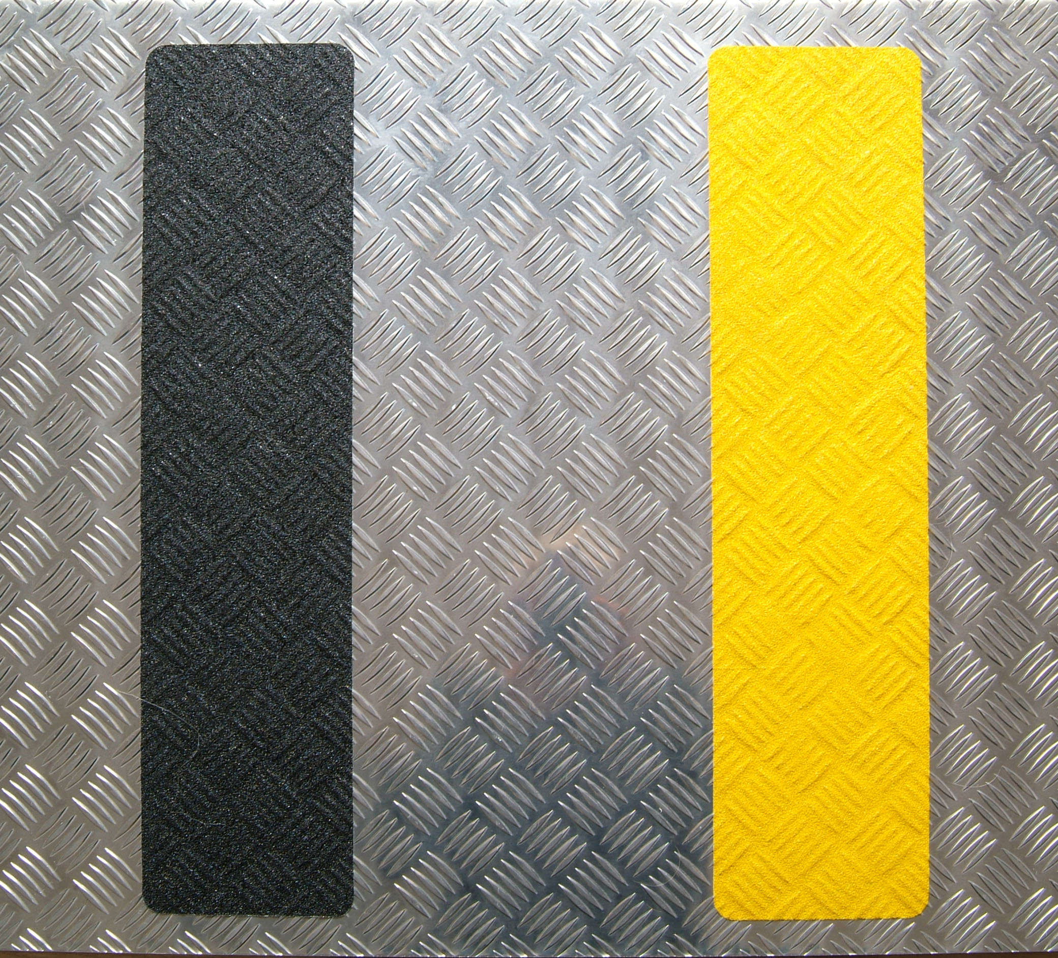Black and yellow conformable safety grip 150mm 610mm on checka plate