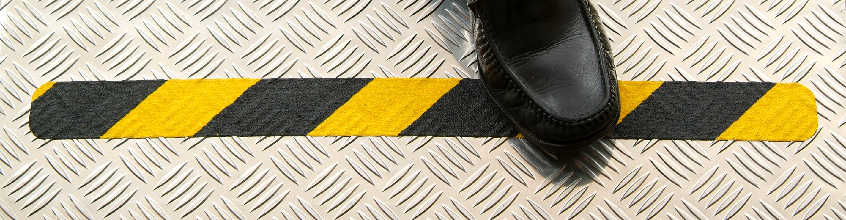 Black Yellow hazard conformable on chequer plate with show